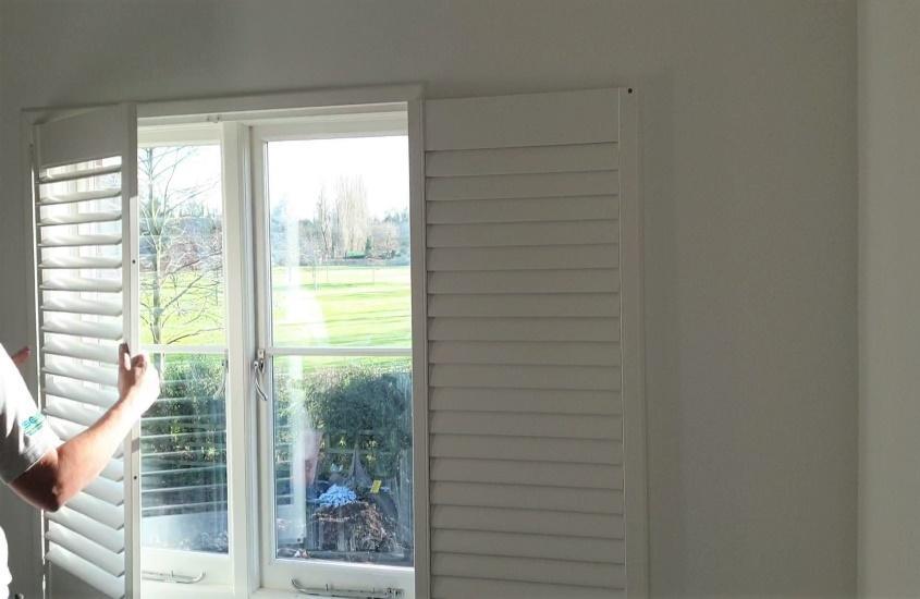 shutters fold back onto side wall