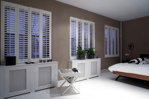 white shutters in bedroom