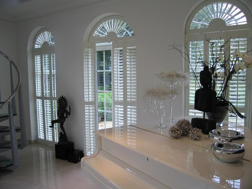arched plantation wood shutters