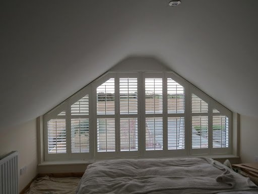 shaped plantation shutters